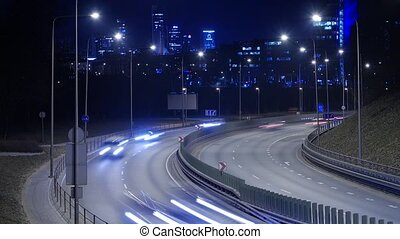 Time Lapse of Busy Freeway Traffic at Night in Vilnius,...