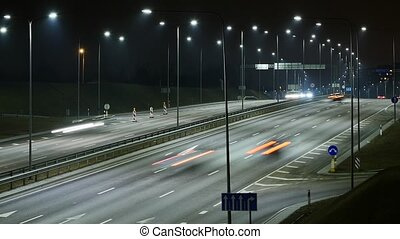 Time Lapse of Busy Freeway Traffic at Night. - Time Lapse of...