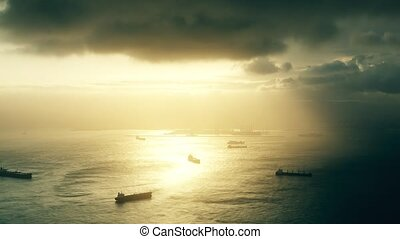 Time lapse of cargo ships and oil tankers at sea at stormy sunset as seen from Gibraltar