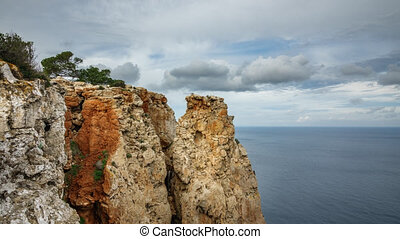 Time lapse of cliff in Ibiza island with mediterranean sea -...