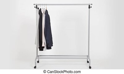 Time lapse of clothes on rack on white background
