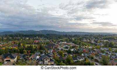 Time lapse of clouds and sunset over homes in Happy Valley Or early Fall Season