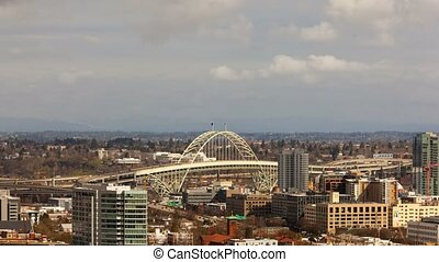 Time lapse movie of moving clouds and auto traffic in downtown city of Portland OR with Fremont Bridge