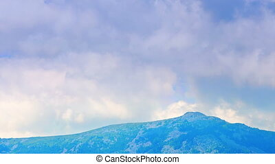Time lapse of clouds mountains in haze summer - Time lapse...