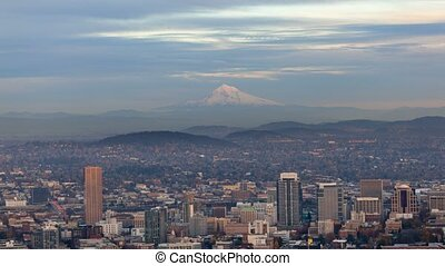 Time lapse of clouds over cityscape with alpenglow on Mt. Hood in Portland Oregon at sunset