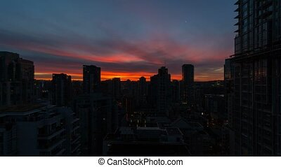 Time lapse of clouds over downtown Vancouver BC from blue...
