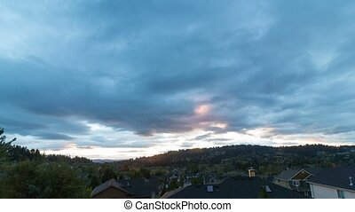 Time lapse of clouds over homes in Happy Valley OR at sunset