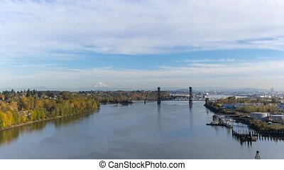 Time lapse of clouds over industrial area in Portland OR along Willamette River in fall season 4k