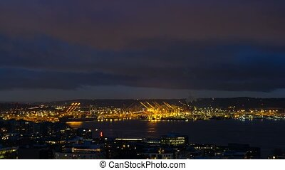 Time lapse of clouds over Port of Seattle along Puget Sound...
