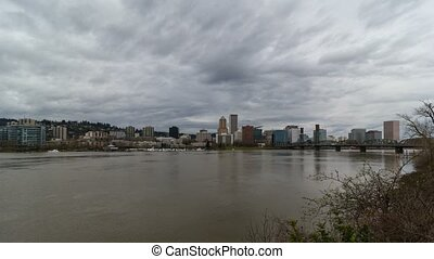 Time lapse of clouds over Portland Or city skyline with Hawthorne bridge along Willamette River