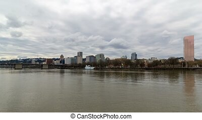 Time lapse of clouds over Portland OR skyline along Willamette River 4k Uhd