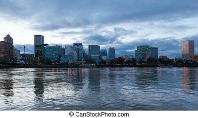 Time lapse of clouds over Portland OR skyline along Willamette River at dusk 4k