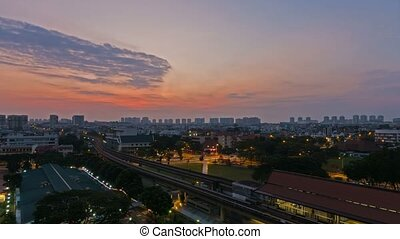 Time lapse of clouds over public MRT and auto traffic in...
