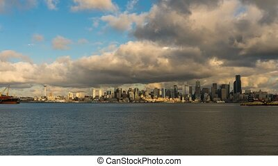 Time lapse of clouds over Seattle WA skyline along Elliot Bay from Alki Beach 4k