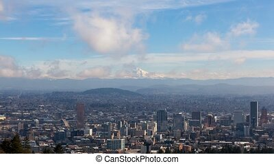 Time lapse of clouds over snow covered mt hood and cityscape...