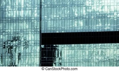 Time lapse of clouds reflecting in a modern skyscraper in...