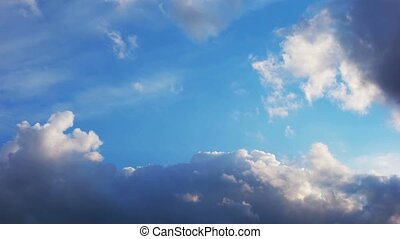 Time lapse of cloudscape. Bright sun shining on back of clouds passing