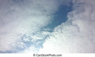 Time lapse of cloudscape with bright sun shining with clouds passing.
