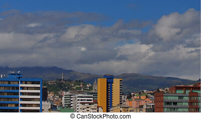 Time lapse of cloudy day in the northern part of the city of Quito with El Panecillo hill in the background - Ecuador