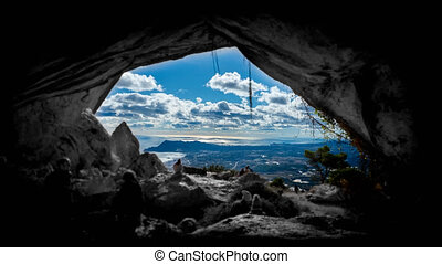 Time lapse of coastline and citys from the cave