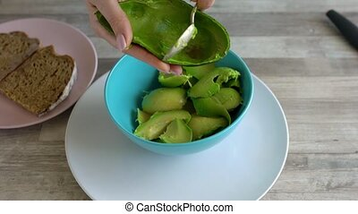 Time lapse of cooking avocado toast - cut the avocado and ...