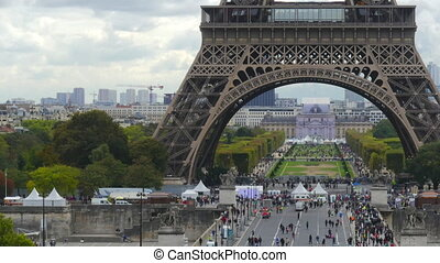 Time lapse of crowded place near the Eiffel tower base and Champ de Mars in Paris, France