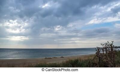 Time lapse of cumulonimbus clouds over the sea coast - Time...