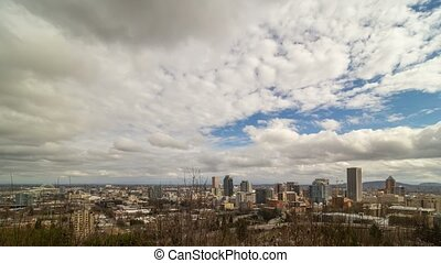 Time lapse of dramatic clouds and highway traffic with cityscape of Portland OR 4k