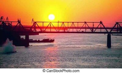 Time lapse of evening sunset near the railway bridge
