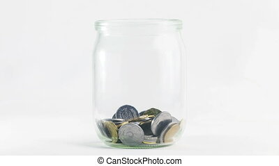 Time Lapse of Falling Coins in the Jar on white background. 4K Ultra HD