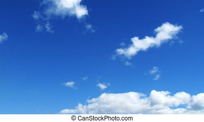 Time lapse of fast moving cumulus clouds over the blue sky. No birds