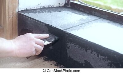 Time lapse of filling gaps between tiles with grout - Time...