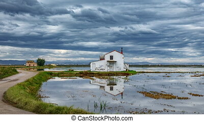 Time lapse of flooded rice field and typical house in Albufera