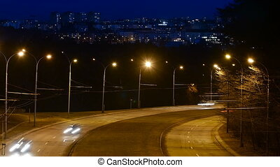 Time Lapse of Freeway Traffic at Night in Vilnius, Lithuania. High-angle view from a bridge.