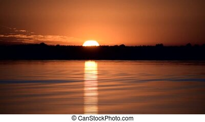 Time lapse of gorgeous sunrise over water of lake or river