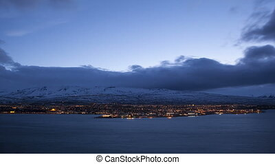Time lapse of Icelandic city Akureyri at night, 4K