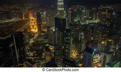 time-lapse of Kuala Lumpur skyline at night. pan up