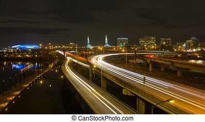 Time lapse of long exposure light trails on freeways in downtown Portland OR at night 4k