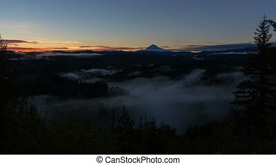 Time lapse of low moving fog over Sandy River with Mt. Hood at Sunrise in Oregon
