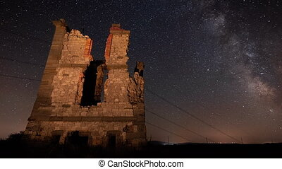 Time Lapse of Milky Way glowing over ancient tower ruins.