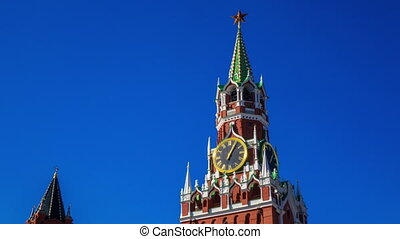 Time lapse of Moscow Kremlin Russia tower clock against blue sky