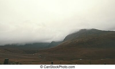 Time-lapse of mountain landscape at misty day - Isle of...