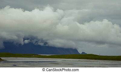 Time Lapse of mountains, gulf and clouds. Iceland.