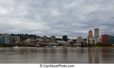 Time lapse of moving clouds over Portland Or downtown city skyline with condos and boats dock along Willamette River