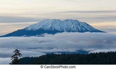 Time lapse of moving clouds over snow covered Mt St Helens in Washington state