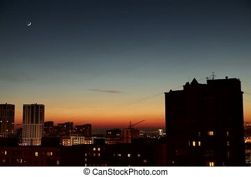 time lapse of new moon at the city