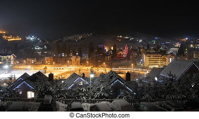 Time lapse of night winter snow village. mountain tourism. winter season