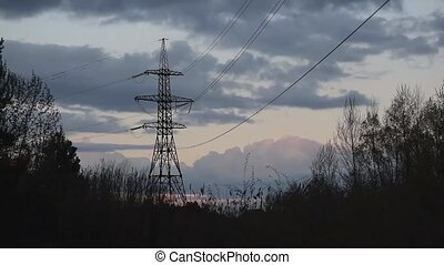 Time lapse of nightfall with transmission tower
