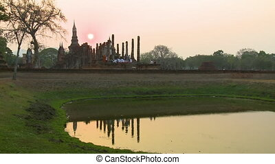Time lapse of people at Sukhothai Park at sunset