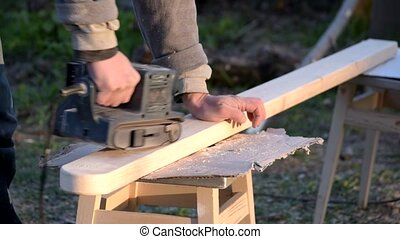 Time lapse of polishing wooden beam with belt sander - Time...